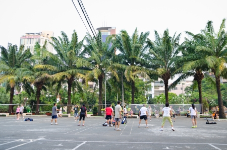 HO CHI MINH, VIETNAM - MARCH 7  Unidentified residents of Ho Chi Minh City  Saigon  play badminton at their leisure, March 7, 2013 in Ho Chi Minh, Vietnam  Stock Photo - 19106969