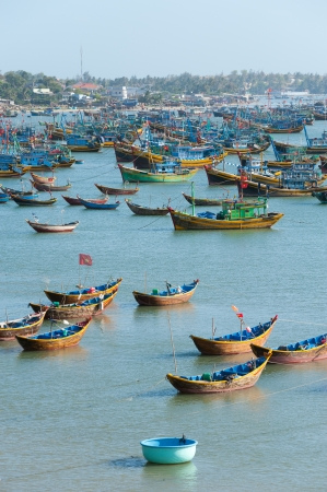 MUI NE, VIETNAM - FEBRUARY 24  Mui Ne is a very popular tourist attraction in Vietnam  A lot of local fishing boats have a day rest till the night, February 24, 2013 in Mui Ne, Vietnam  Stock Photo - 19106963