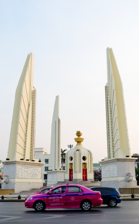 the monarchy: BANGKOK, THAILAND - FEB 17  Democracy Monument was raised in 1939 to commemorate Siamese Revolution of 1932 which led to establishment of a constitutional monarchy, Feb 17, 2013, Bangkok, Thailand