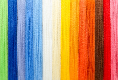 woolen colorful threads - green, blue, white, yellow, orange, brown, red, pink Stock Photo - 19221119