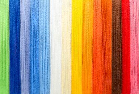 stitchwork: woolen colorful threads - green, blue, white, yellow, orange, brown, red, pink
