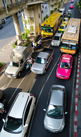 BANGKOK, THAILAND - FEB 17  Many vehicles move along Thanon Silom near Lumpini Park, Feb 17, 2013, Bangkok, Thailand  It is third in international visitors MasterCard Global Destination Cities Index  Stock Photo - 19212981