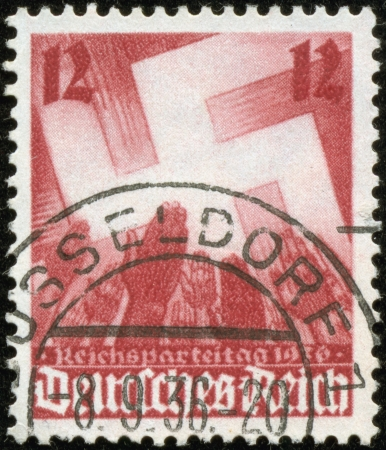 fascist: GERMANY - CIRCA 1936  A stamp printed by the fascist Germany Post is entitled  Reichsparteitag   Imperial party convention , circa 1936