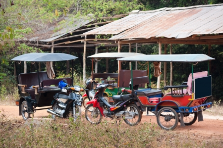 three empty tuktuks at a stop, Cambodia Stock Photo - 19382479