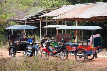 three empty tuktuks at a stop, Cambodia Stock Photo - 19382479