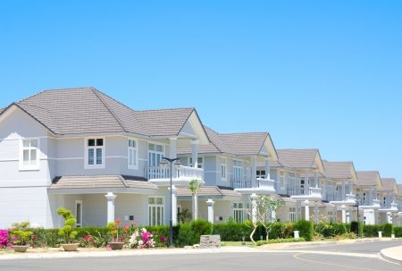 shore line: street of new cottages in southern resort Stock Photo