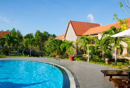 resort life: house and outdoor swimming pool, southern Vietnam