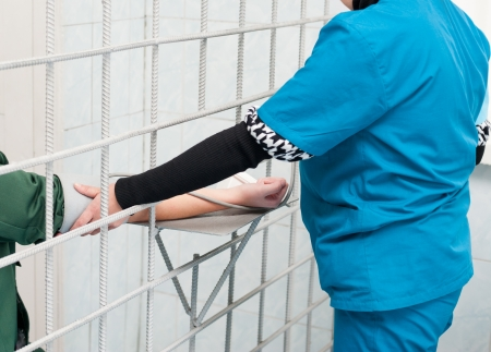 at female prison - nurse measures prisoners blood pressure 写真素材
