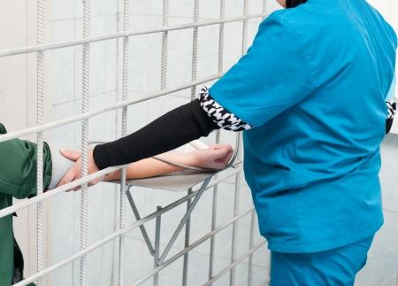 at female prison - nurse measures prisoners blood pressure Standard-Bild
