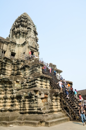 ANGKOR, CAMBODIA - FEB 20  Unidentified tourists climb to a praying tower at Angkor Wat  It is a part of the ancient Khmer complex Angkor, Feb 20, 2013, Angkor, Cambodia