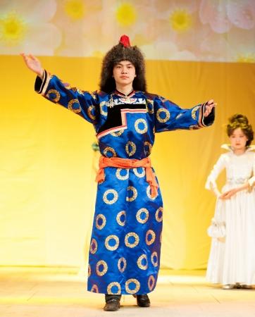 ulan ude: ULAN-UDE, RUSSIA - APR 16  An unidentified man model demonstrates a Buryat national costume at the fashion show of Radzhana Baldayeva, a known hair stylist, Apr, 16, 2010, Ulan-Ude, Buryatia, Russia