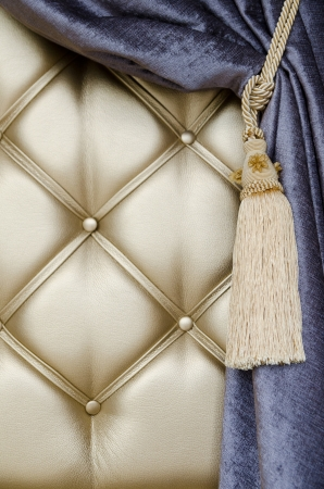 opalesce: golden upholstery, blue curtain with support and tassel