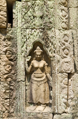 khmer: the low relief sculpture of a devata, a Buddhist female deity, in Angkor, Cambodia Stock Photo