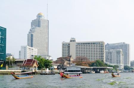 nicknamed: BANGKOK, - FEB 17  Some pleasure boats sail on Chao Phraya river near SSumption College, Feb 17, 2013, Bangkok, Thailand  Bangkok is nicknamed Asian Venice due to developed river transportation