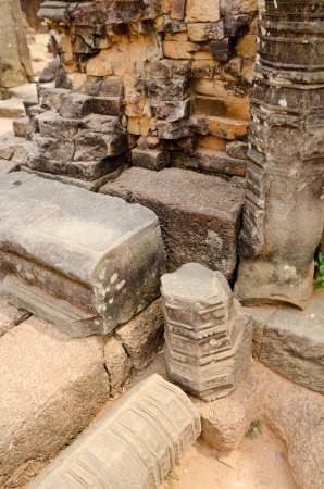 fragments: ruined walls and fragments of pillars in Angkor, Cambodia