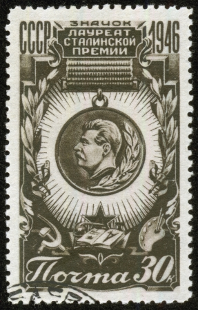 laureate: SOVIET UNION - CIRCA 1946  A stamp printed by the Soviet Union Post shows a badge Stalin Prize laureate, circa 1946  Editorial
