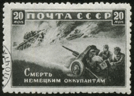fascist: SOVIET UNION - CIRCA 1942  A stamp printed by the Soviet Union Post is entitled Death to German Invaders , circa 1942  It shows Russian artillerymen shooting at fascist tanks