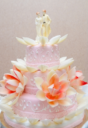 three level pink wedding cake with lilies photo