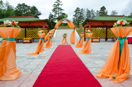 organza: outdoor restaurant prepared and decorated for wedding ceremony Stock Photo