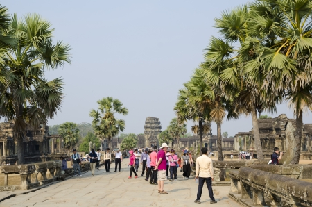 ANGKOR, CAMBODIA - FEB 20  A lot of tourists see round Angkor Wat  It is a part of the ancient Khmer temple complex Angkor, the main tourist attraction in Cambodia, Feb 20 2013, Angkor, Cambodia
