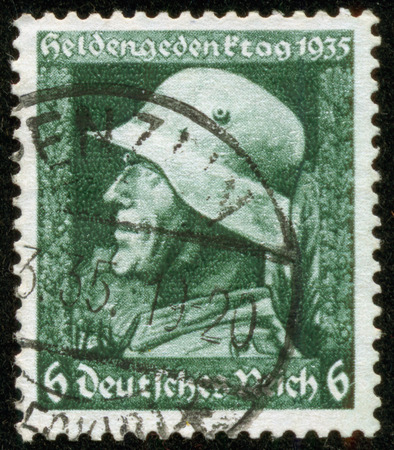 fascist: GERMANY - CIRCA 1935  A stamp printed by the fascist Germany Post is entitled Memorial Day  It shows a soldier with a fascist banner, circa 1935 Editorial