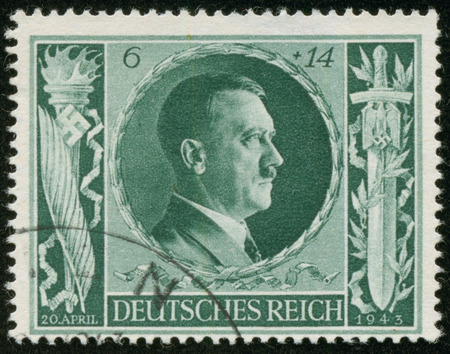 fascist: GERMANY - CIRCA 1941  A stamp printed by the fascist Germany Post is a portrait of Adolf Hitler, circa 1941