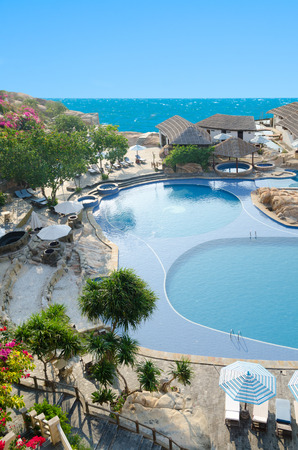 swimming pool with sunshades and sunloungers near hotel Stock Photo - 25621605