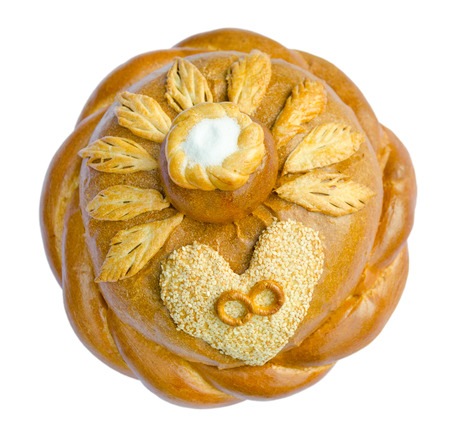 browned: round loaf of wedding bread, rings on heart, salt on top  Russian customs and traditions