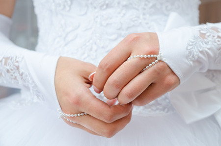 clasping: clasping hands of bride being nervous before courtship display