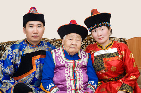 grandmother and grandson: buryat  mongolian  family  grandmother, grandson and his wife, in national costumes