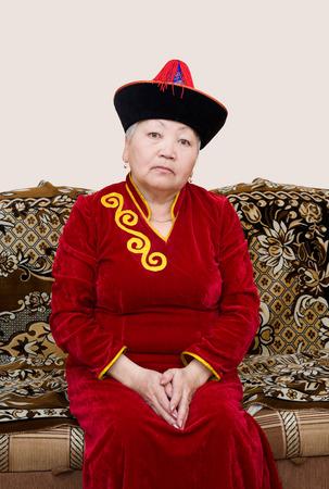 velvet dress: buryat (mongolian) senior woman pose in national costume