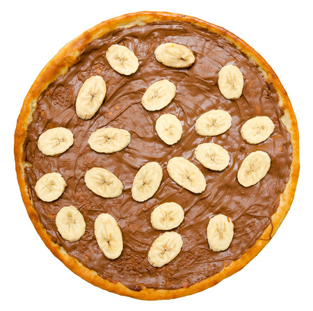 sweet chocolate pizza with banana slices, isolated, top view