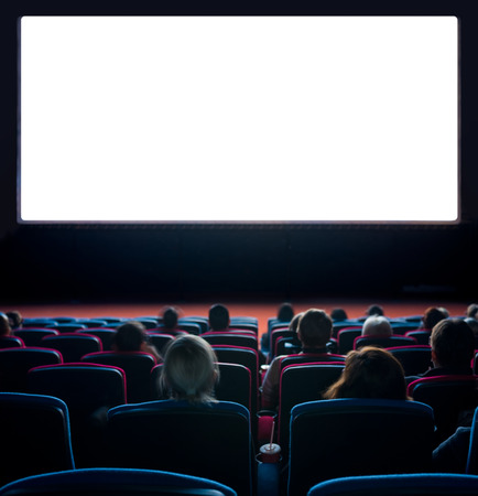 viewers watch motion picture at movie theatre, long exposure