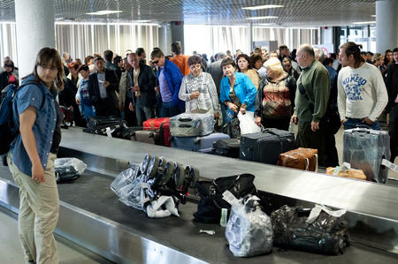 travelled: ST  PETERSBURG - MAY 28, 2011  Unidentified passengers wait for baggage at Pulkovo airport  In 2013 roughly 12 85 mln ppeople travelled there, making it the 3rd busiest airport in Russia