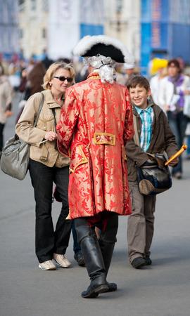 jackboots: ST  PETERSBURG - MAY 29, 2011  An unidentified actor dressed as Peter I talks to a woman and a boy agreeing on a photo shoot for pay  The city was the 10th most popular European tourist city in 2012