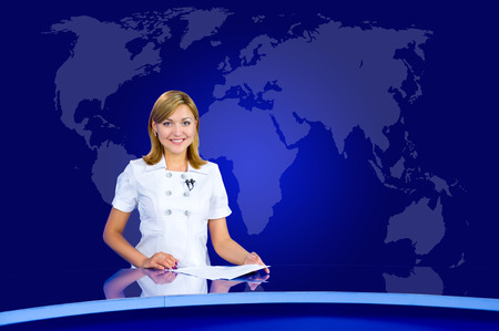 television anchorwoman at studio, with world map in the background Stock Photo