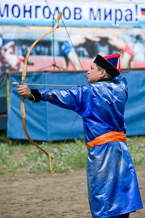naadan: ULAN-UDE, RUSSIA - JULY 17, 2010  A man is ready to shoot, Mongolian archery competition  The 4th General Session of the World Mongolians Convention