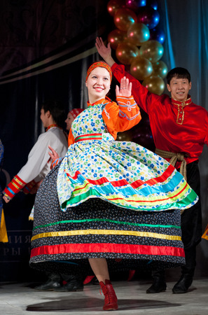 ulan ude: ULAN-UDE, RUSSIA - FEBRUARY 10, 2010  Unidentified woman dancer performs a Russian folk dance at the Annual Republican Best Sportsmen Award   Editorial