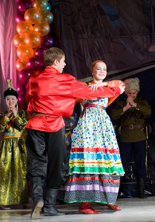 ulan ude: ULAN-UDE, RUSSIA - FEBRUARY 10, 2010  Unidentified dancers  a man and a woman  perform a Russian folk dance at the Annual Republican Best Sportsmen Award  Editorial