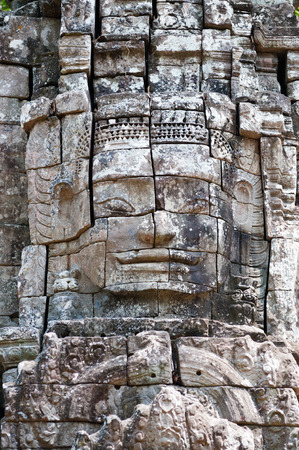 Angkor - faces of Avalokitesvara, a buddhist deity Stock Photo - 27577247