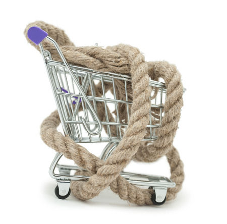 shopaholism: concept of shopaholism - shopping trolley wound by rope
