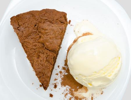 piece of chocolate cake and ball of ice cream photo