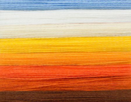 stitchcraft: woolen colorful threads - blue, white, yellow, orange, brown
