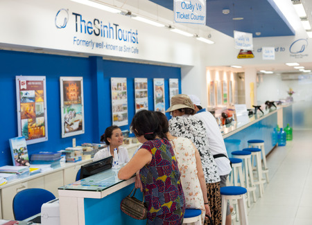 HO CHI MINH, VIETNAM - JULY 15, 2014: Unidentified people stand at the counter of the Sinh Tourist. According to many reviews the company seems to be Vietnam's most popular and reputable tour agency. 報道画像