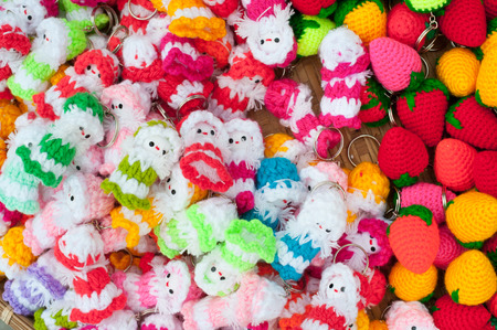 trinkets: a lot of knitted trinkets - dolls and strawberries
