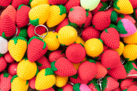 trinkets: a lot of knitted trinkets - colourful strawberries