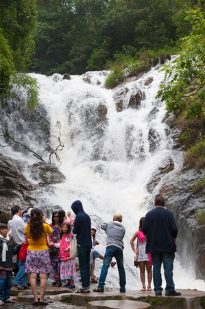 waterfall in the city: DALAT, VIETNAM - JULY 28, 2014: Unidentified tourists pose and take pictures in front of Datanla waterfall. It is located 5 km away from the city center. Editorial