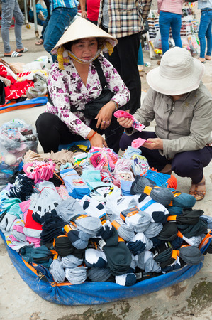 evenings: DALAT, VIETNAM - AUGUST 2, 2014: An unidentified woman sells socks at the central city market. It is quite chilly in the evenings in Dalat.