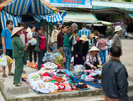 evenings: DALAT, VIETNAM - AUGUST 2, 2014: Unidentified people sell and buy warm clothes at the central city market. It is quite chilly in the evenings in Dalat. Editorial