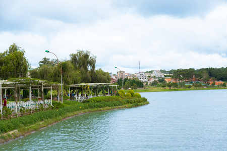 cau: DALAT, VIETNAM - JULY 17, 2014: A distant view at a cafe in the Bich Cau Garden. It is located on a small island in the northern part of Xuan Huong Lake.